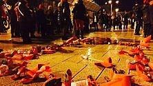 """Scarpe rosse in piazza """"No violenze su donne"""""""