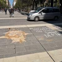 Via Sparano, un murale su Gesù disegnato sulla nuova pavimentazione