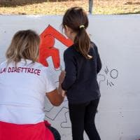 Bari, Save the children colora le scuole con l'omaggio a Keith Haring