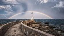 L'arcobaleno abbraccia  il faro di Otranto