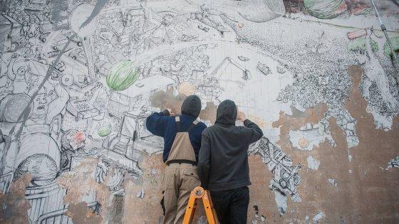 Bologna, attivisti denunciati per aver cancellato i murales di Blu. E la città si divide
