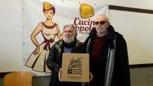 Libera dona mille kg    di spaghetti / foto alle Cucine Popolari