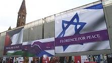 Simbolica stretta di mano tra Israele e Palestina