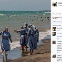 Burkini, l'imam di Firenze posta immagine di suore al mare: account sospeso da Facebook