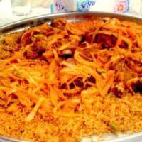 Migranti, nella scuola del Varesotto il riso alla curcuma dei profughi nigeriani. La...