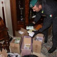 Varese, si fingevano sceicchi per truffare i clienti col traferimento di valuta: 15 in manette