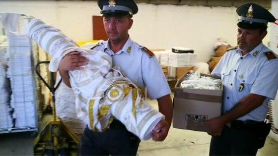 Varese, finanza scopre lavoratori in nero e merce contraffatta in laboratorio tessile cinese