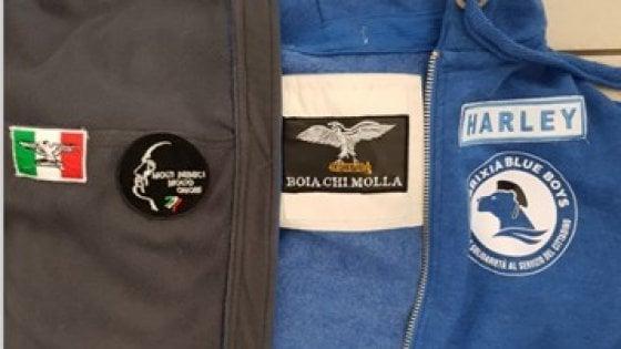Brescia, ronde neofasciste in divisa e manganello: sette denunciati tra i 'Brixia Blue Boys'
