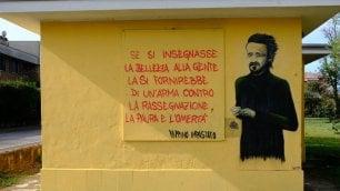 """Il ritratto di Impastato  su un muro di Buccinasco  la """"Platì del Nord"""""""