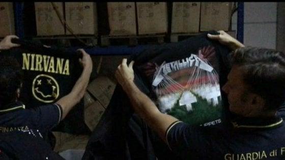 Gadget e magliette falsi ai concerti rock di San Siro e al Forum: sequestro da oltre 3 milioni euro