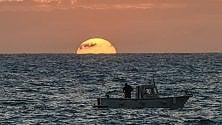 Barche e tramonti, Ischia in due scatti