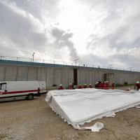 Tiburtina, l'allestimento della tendopoli per i migranti