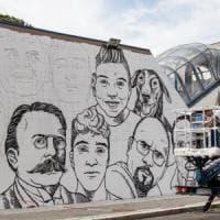 Roma, i  muri della stazione Lido Nord parlano con i volti delle persone