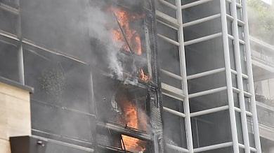 Palazzo a fuoco vicino alla Gran Madre  una donna salvata dai vigili    foto     video