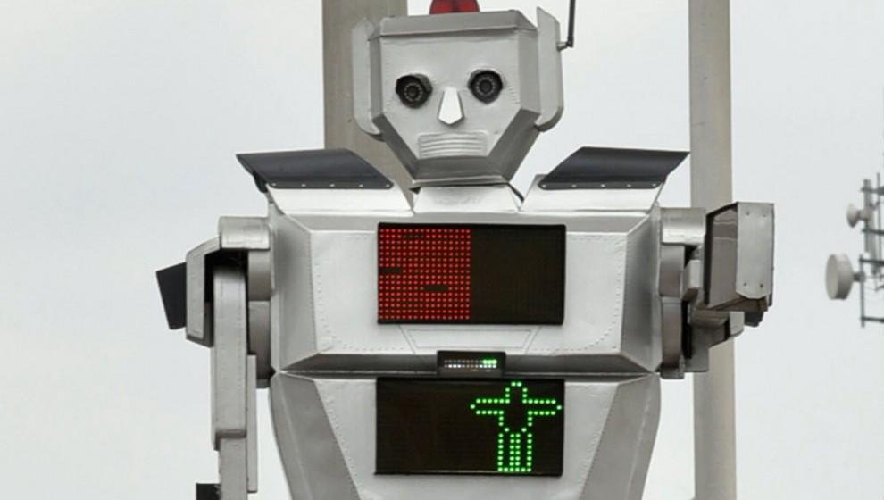 """Congo, <span tabindex=""""-1"""" class=""""hP"""" id="""":9de"""">un robot-sema<wbr></wbr>foro per dirigere il traffico</span>"""