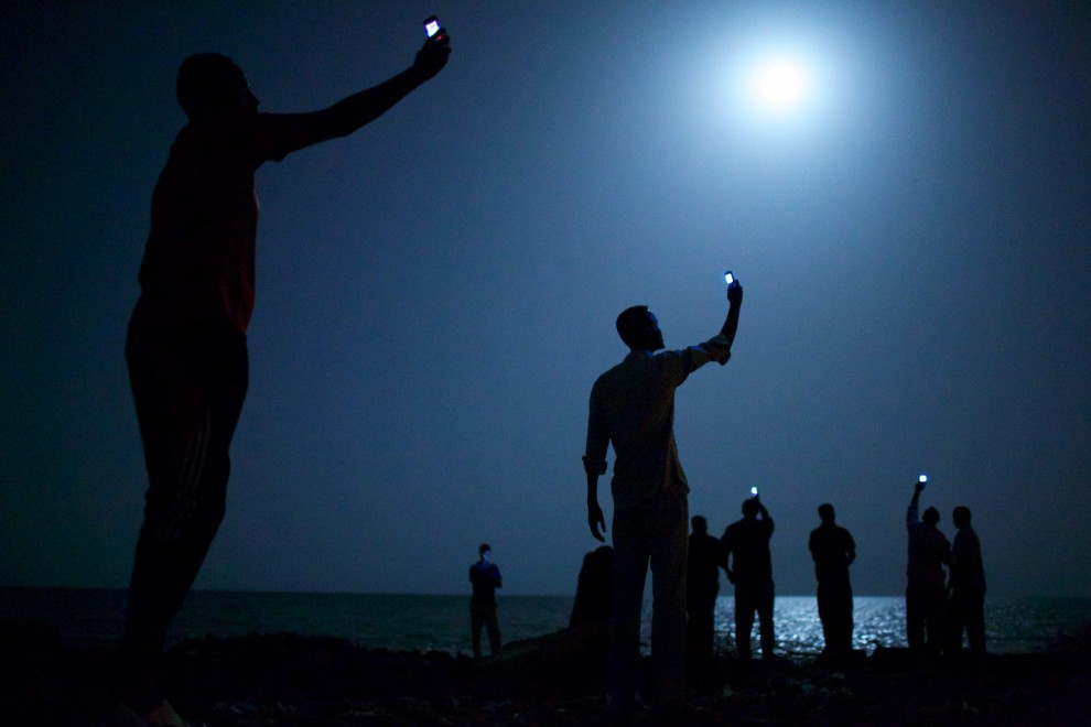 World Press Photo 2014, i migranti ritratti nella foto dell'anno: i vincitori
