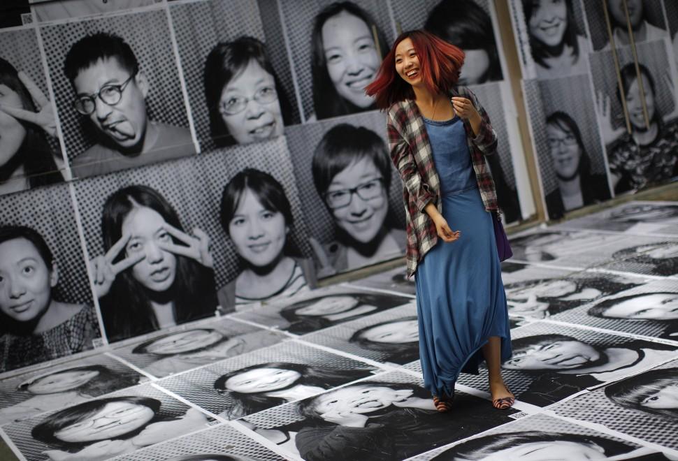Volti da tutto il mondo: l'arte collettiva di Jr arriva a Shangai
