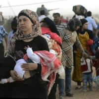Is, emergenza profughi in Turchia. In tre giorni 130mila curdi