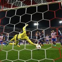 Champions, Atletico e Arsenal avanti. Il Benfica è eliminato