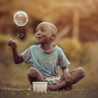 Che cos'è un sorriso? Il vocabolario fotografico dell'infanzia