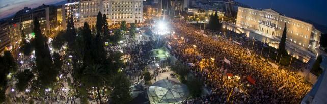 """Tsipras:  """"Basta ricatti, se vince sì potrei lasciare""""  Merkel: """"Se fallisce l'euro,  fallisce la Ue """"   Borse in rosso,    Milano -5%   /    foto  Wall Street"""