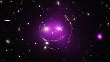 """In cielo c'è uno """"Stregatto cosmico"""" disegnato da antiche galassie"""