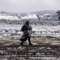 Migranti, la stagione più dura: in viaggio sotto la neve