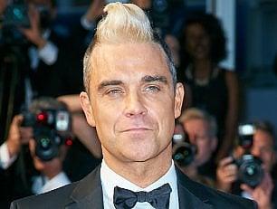 Robbie batte Jimmy Page nella 'battaglia delle ville'
