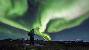 Reykjavik spegne tutte le luci  per ammirare l'aurora boreale