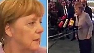 """Merkel: """"Cosa è quell'aggeggio?"""" Stupita da videocamera a 360°"""