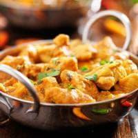 Dal curry alle mandorle: le più famose ricette etniche a base di pollo