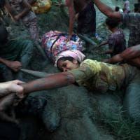 I due fotografi che hanno smesso di scattare per salvare la rifugiata Rohingya