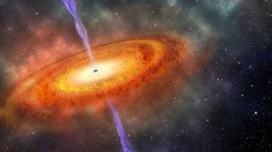 """Il più lontano buco nero mai scoperto:  un """"faro"""" nell'Universo primordiale"""