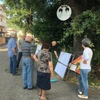 Pescara, cittadini fanno da scudo  contro l'abbattimento di una quercia
