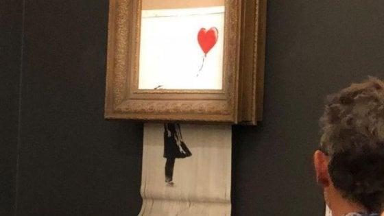 L'ultima provocazione di Banksy: quadro si autodistrugge a un'asta