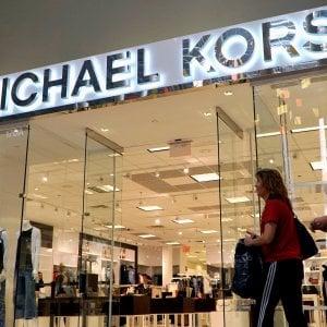 Kors cresce meno delle attese, ma punta su Versace