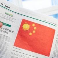 """Coronavirus, la vignetta danese che offende il popolo cinese. L'ambasciatore: """"Vogliamo le..."""