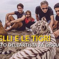 Bocelli in spiaggia con due tigri: lo scatto fa discutere i social