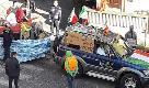 Formello, nella sfilata di carnevale spunta barcone dei migranti con la scritta