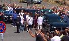 Funerale Diabolik: l'arrivo della salma tra applausi, saluti romani e cori da stadio
